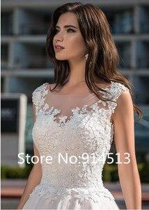 Image 3 - מרתק O צוואר אונליין חתונת שמלת טול עם תחרת אפליקציות כדור שמלת שמלות כלה כפתור חזרה Vestido דה Noiva