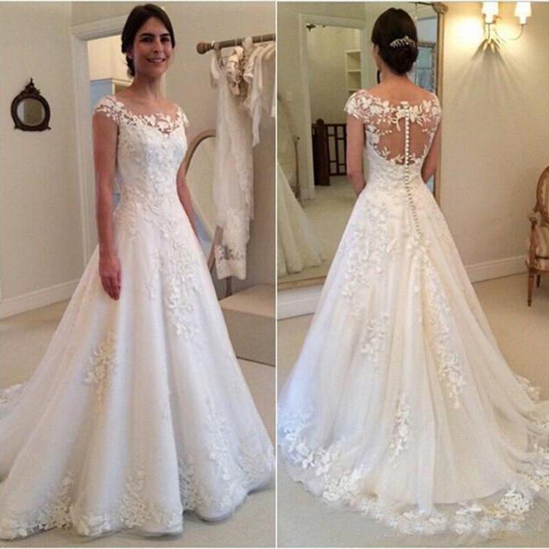 2020 Modest Lace Appliques Wedding Dresses A Line Sheer Bateau Neckline See Through Button Back Bridal Gowns Cap Sleeves Dress