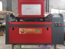 6090 laser engraving machine  60w CO2 laser with axis of rotation