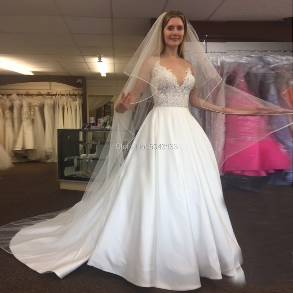 Exquisite Lace Appliques Satin A Line Wedding Dresses 2020 Illusion V Neck Backless Floor Length Bridal Gowns With Beaded Sash