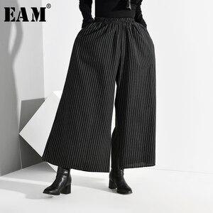 Image 1 - EAM pantalones de pierna ancha a rayas largo para mujer, pantalón negro, cintura alta elástica, corte holgado, moda, Primavera, Otoño, 2020, SA9550