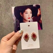Boucles d'oreilles en forme de goutte d'eau pour femmes, nouvelle collection coréenne populaire, cristal rouge, strass, petite perle simulée