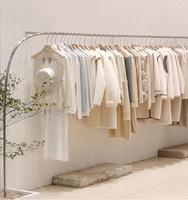 Creative stainless steel brushed silver hanging clothes shelf in clothing store