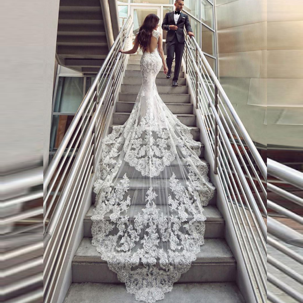 Luxe perlée sirène robes de mariée 2019 chérie Cap manches dos nu longue queue Applique dentelle bouton retour robe de mariée