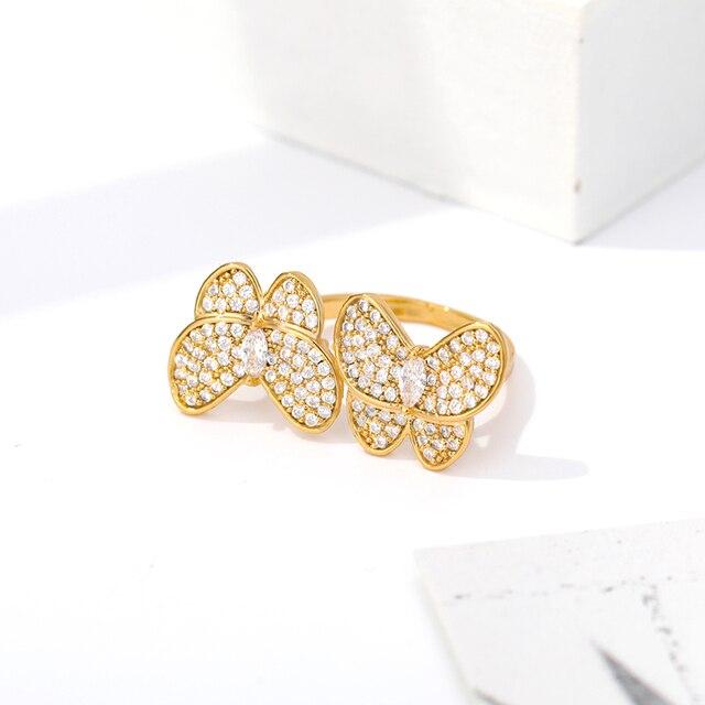 Фото женское кольцо с бабочкой золотистое/серебристое обручальное