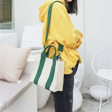 Korean version of the new small bag female ins canvas small square bag Messenger student simple wild one shoulder canvas bag world brand small bags new fashion korean version of the small square bag lock buckle handbag simple wild shoulder messenger bag