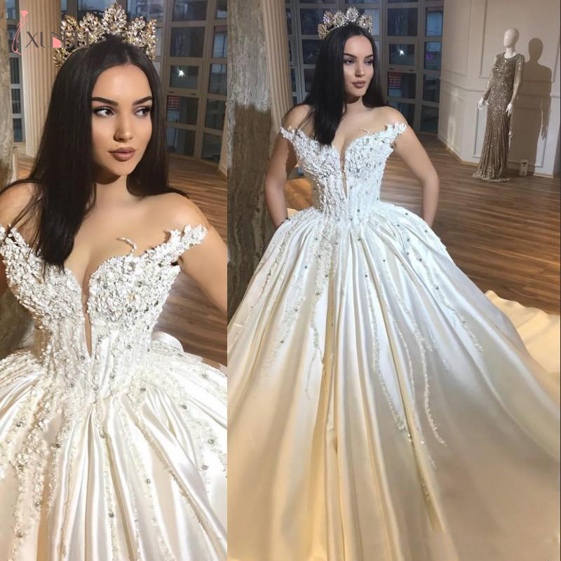 2020 New Luxury Wedding Dresses 3D Flowers Lace Applique Beaded Satin Crystal Off Shoulder Court Train Arabic Dubai