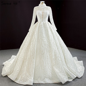 Image 1 - Luxury Ivory High Neck Sexy Plus Size Wedding Dresses 2020 Long Sleeves Beading Pearls Bridal Gowns BHM67129 Couture Dress