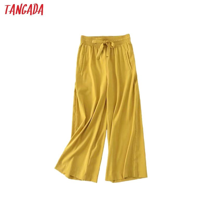 Tangada 2020 Summer Fashion Women Yellow Casual Pants Trousers Strethy Waist Pockets Zipper Female Pants 5B11