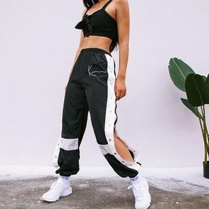 Image 1 - Houzhouジョギング女性パンツファッションパッチワークスウェットパンツハーレムカジュアルサイドスプリットボタンpanelledハイウエストズボンストリート