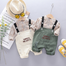 купить New Baby Boy Clothes New Fashion Shirt Bib Pants 2pcs Children's Sets Classic Popular Plaid Cute Letter Print Boy 0-3T Sets по цене 627.21 рублей