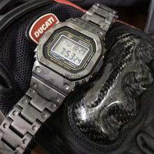 جديد التمويه سبائك التيتانيوم الساعات و الحافة ل DW5600 GW M5610 GW5000 DW5035 حزام معدني سوار الصلب غطاء مع أدوات
