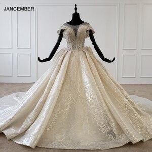 Image 1 - HTL1137 błyszcząca suknia ślubna nakryty rękawem o neck zasznurować gorset suknie ślubne wzburzyć pociąg ins gorąca sprzedaż świecący vestidos novia