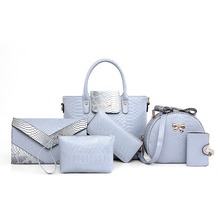 ki pde popular fashion mother bag is European and American style serpentine handbag with six pieces of single shoulder