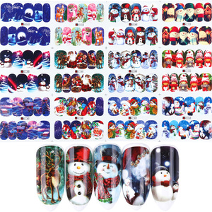 Image 2 - 12pcs Christmas Nail Stickers Santa Claus Elk Snowman Water Transfer Sliders for Nails Cartoon Winter New Year Manicure JIBN/A 1