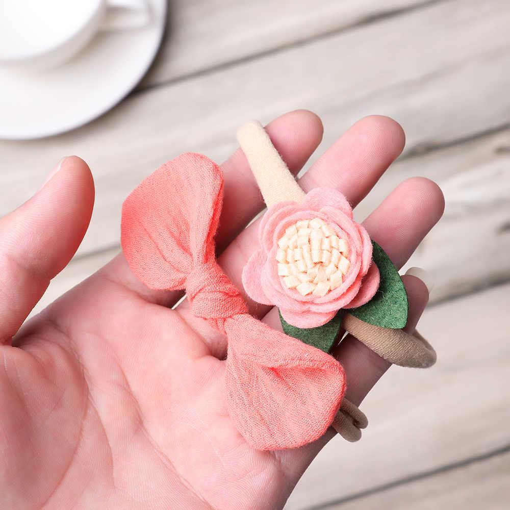 1PC เด็กหญิงน่ารักดอกไม้แถบคาดศีรษะยืดหยุ่นทารก Bowknot น่ารัก Headwear ไนลอนน่ารัก Hairband เด็กเจ้าหญิงอุปกรณ์เสริมผม