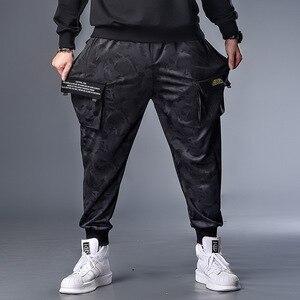 Image 1 - PLUS 7XL XXXXL męskie jesień zima kamuflaż na co dzień Jogger Camo odzież sportowa workowate spodnie haremki spodnie z paskiem spodnie dresowe