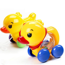 цена на Wind Up Toys Rattles pull rope duck Baby Rattles Pull rope Duck Animals Hand Shaking Bell Rattles Music Handbell Kids kid toy