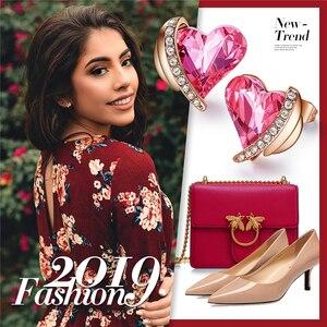Image 5 - CDE Frauen Gold Ohrringe Schmuck Verziert mit Kristallen von Swarovski Rosa Engel Flügel Herz Stud Ohrringe Feine Schmuck Geschenke