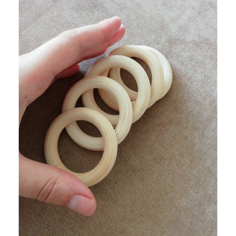 Купить с кэшбэком 5pcs Natural Wooden Baby Teething Rings 55mm/68mm Necklace Bracelet DIY Making Crafts Beech Wooden Natural Safe Teether Toys