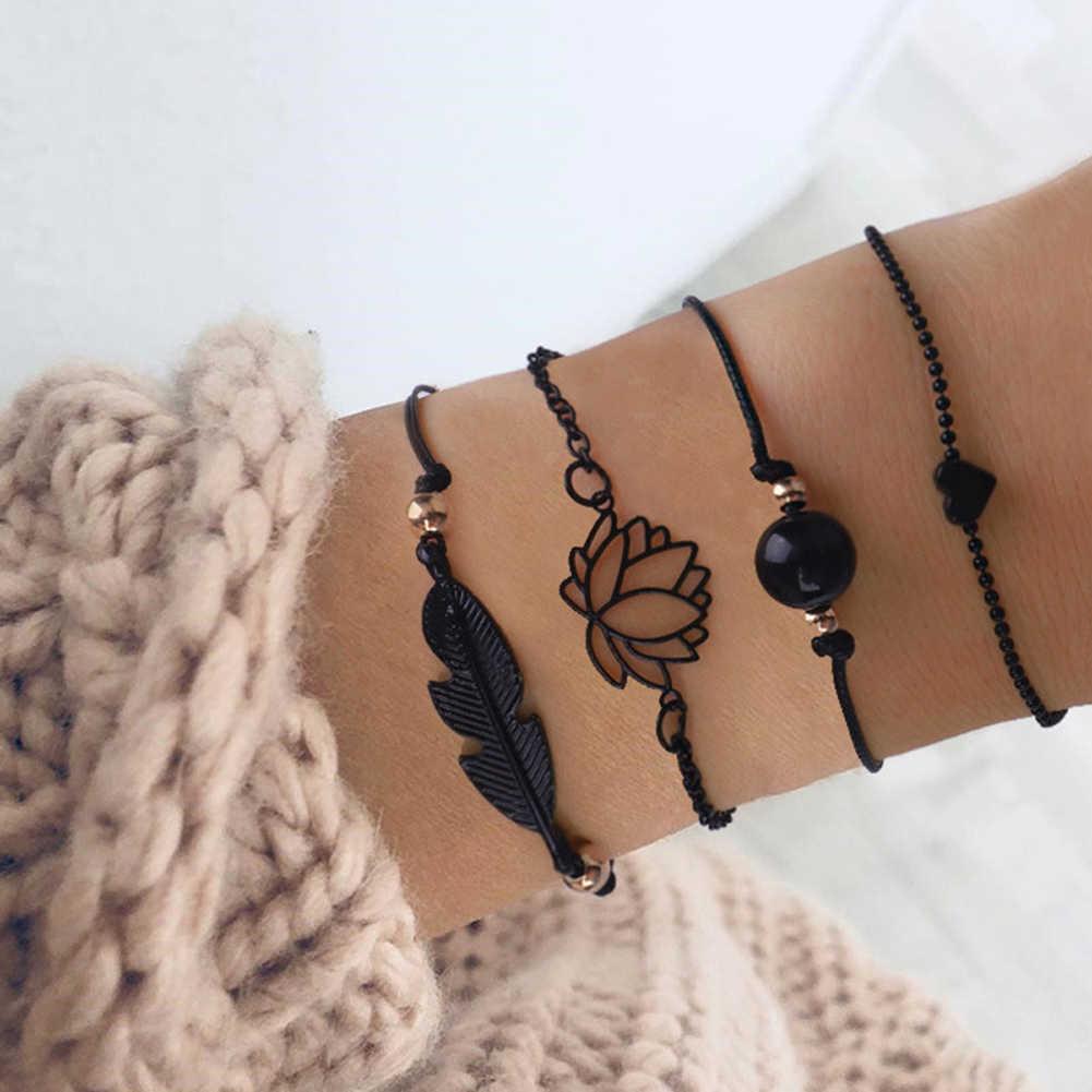 4 個ゴシック黒の羽蓮ブレスレットセットハートチャーム自由奔放に生きる腕輪女性の手首のチェーンブレスレットファッションジュエリー