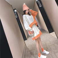Two piece color matching shirt skirt women's suit net red foreign Korean version of the lazy wind suit early autumn