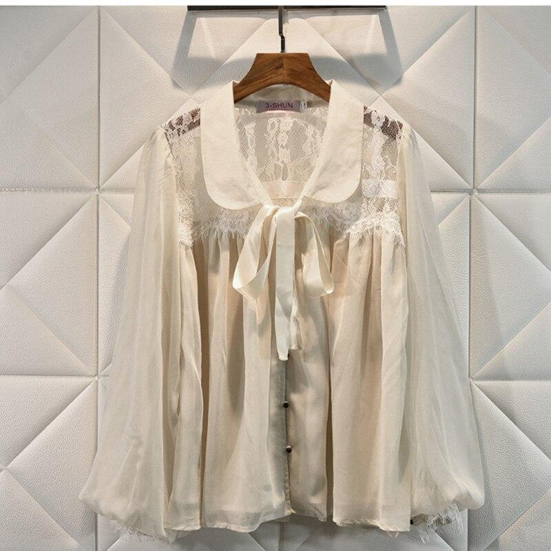 Chemises de luxe design pour femmes manches lanternes Vintage col claudine dentelle mousseline de soie Blouse hauts