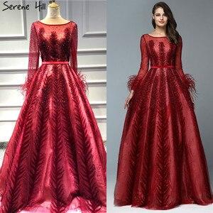 Image 3 - Lüks şarap kırmızı Dubai tasarım abiye uzun kollu tüyleri kristal resmi elbise 2020 Serene tepe LA70013