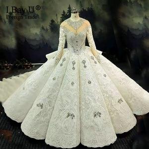 Image 1 - 100% תמונה אמיתית יוקרה בלינג 3D אבנים חתונת שמלה ארוך שרוולים 2020 קריסטל כדור שמלה נפוחה 180cm רכבת
