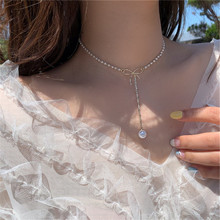 Bohemian ladies necklace bow freshwater pearl pendant necklace female temperament shiny crystal clavicle chain fashion jewelry fringed crystal necklace clavicle chain female moon imitation pearl multilayer necklace luxury personality ladies collar jewelry
