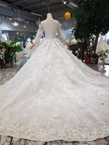Image 2 - BGW HT4304 specjalne suknie ślubne z piórkiem przezroczyste plecy ręcznie robiony guzik suknia ślubna dla dziewczynki Vestido De Noiva Princesa