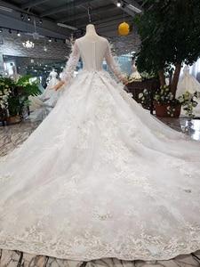 Image 2 - Bgw HT4304 特別ウェディングドレスと羽のためのシースルーバック手作りボタンブライダルドレス vestido デ noiva プリンセサ