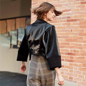 Image 5 - [EAM] luźny krój czarny asymetryczna kurtka ze skóry sztucznej nowa z klapami z długim rękawem płaszcz damski moda fala wiosna jesień 2020 1H079