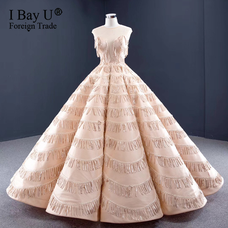 2020 Sexy Tassel Luxury Wedding Dresses Sheer Neck Sequined Sleeveless Bride Gowns