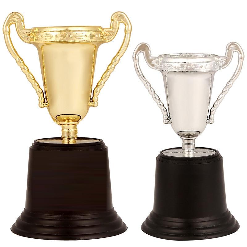 1Pcs Champion Golden Cups Toys For Children Trophy Sports Winner Educational Props Kids Favor Reward Prizes Toys For Children