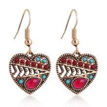 цена на Vintage Ethnic Love Earrings For Women Fashion Simple Hollow Out Heart Shape Beads Drop Earrings Oorbellen
