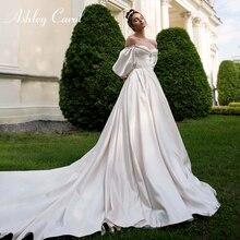 애슐리 캐롤 새틴 a 라인 웨딩 드레스 2020 퍼프 슬리브 구슬 크리스탈 아가 신부 드레스 단추 빈티지 신부 가운