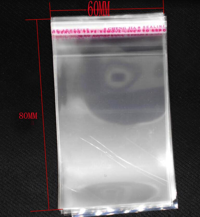 Free Shipping 6*8cm 200pcs For Candy Gift Clear Mini Small Plastic Bags For Jewelry Bag Flap Self Adhesive Seal OPP Package Bag