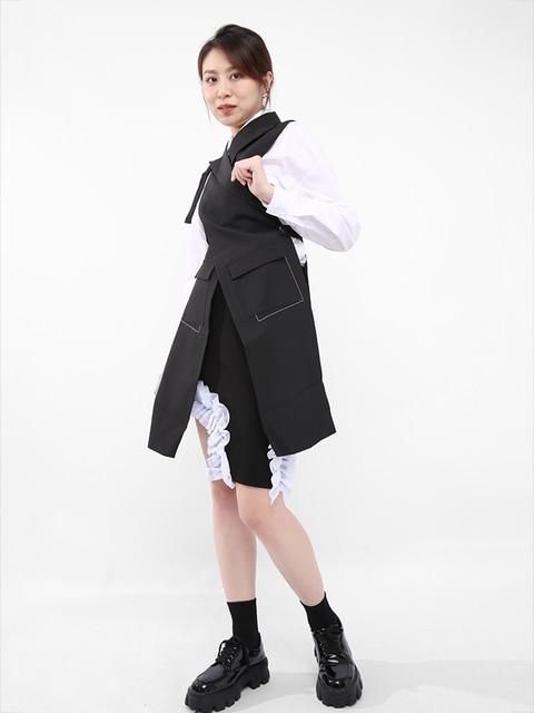 [EAM] Women Loose Fit Black Button Cross Irregular Long Vest New Lapel Sleeveless Fashion Tide Spring Summer 2021 1DD929701 4