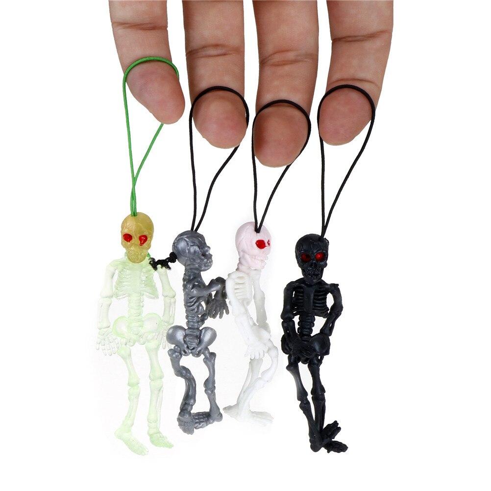 2pcs/lot Rubber Scaryskull Toys Mini Luminous Glow In The Dark Skeleton Hanging Decoration
