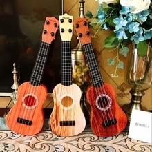 Children's music small guitar can play medium ukulele simula