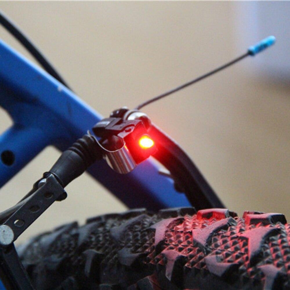 1pc Red Bicycle Bike Cycling Nano Brake LED Light Mini Travel W/ CR1025 Battery