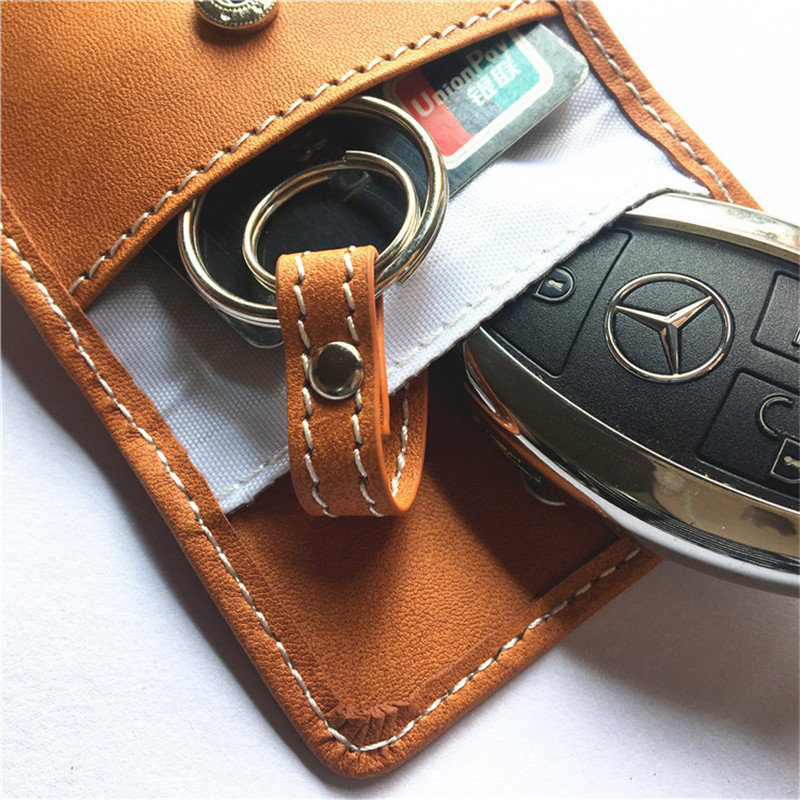 Image 2 - New Leather Signal Blocking Keyless Entry Car Key RFID Cover Pouch Case Bag 1Pc True leather double deck car shielded key pack-in Key Case for Car from Automobiles & Motorcycles