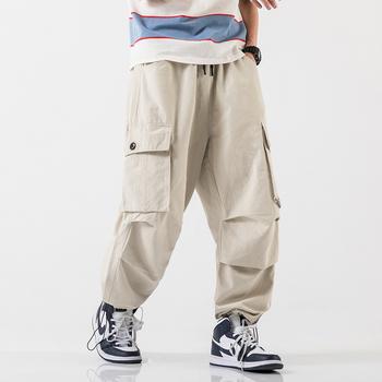 Męskie spodnie Cargo męskie Hip Hop luźna odzież uliczna bawełniane spodnie dorywczo męskie męskie spodnie biegaczy męskie modne spodnie dresowe męskie tanie i dobre opinie VOLGINS Harem spodnie Mieszkanie COTTON Kieszenie Luźne Pełnej długości Na co dzień Midweight Suknem Kostki długości spodnie