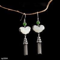 KJJEAXCMY Fine Jewelry s925 sterling silver jewelry ethnic style lady Hetian jade earrings Ruyi tassels new