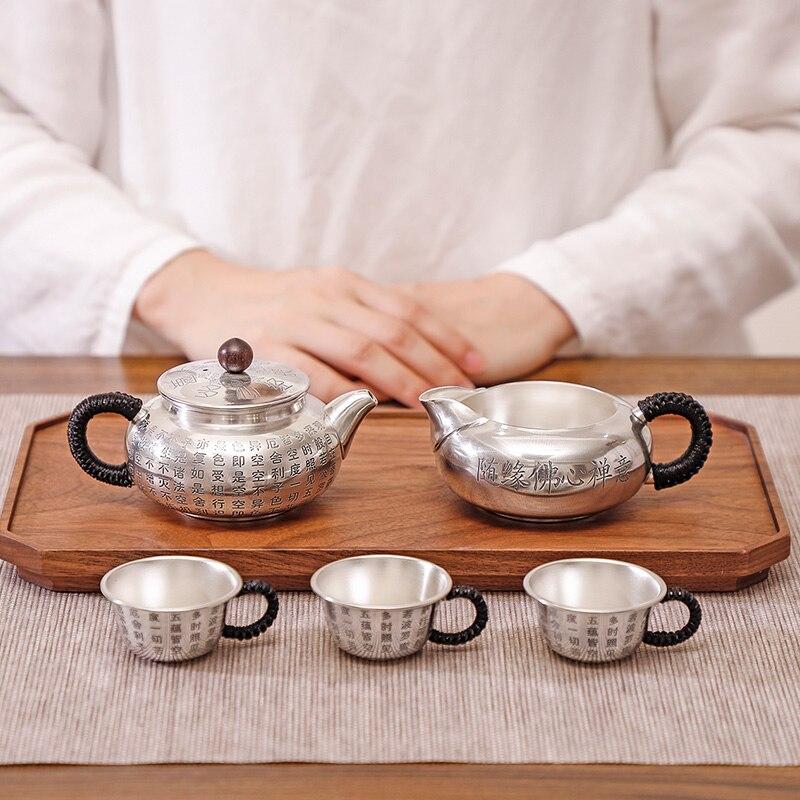 Juego de té de plata de ley 999 corazón Sutra hecho a mano juego de té plateado de gama alta juego de té regalo tetera de plata de ley