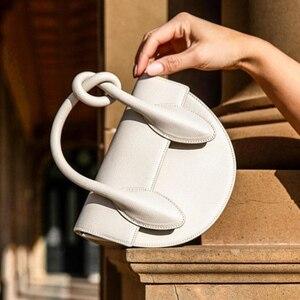 Bag female 2020 new European and American niche designer semi-circular small bag knotted shoulder diagonal bag