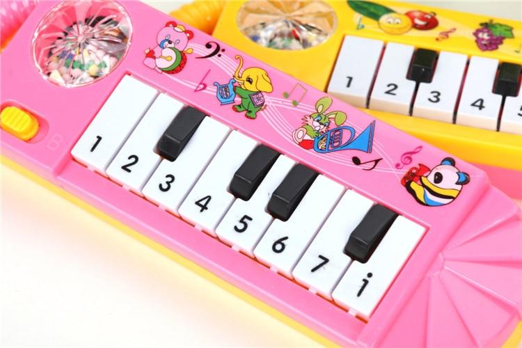 Mini 8 Key Electronic Keyboard With Snowflakes Vibration Sound Making Electronic Keyboard Small Hand Music Piano Smart Music Toy