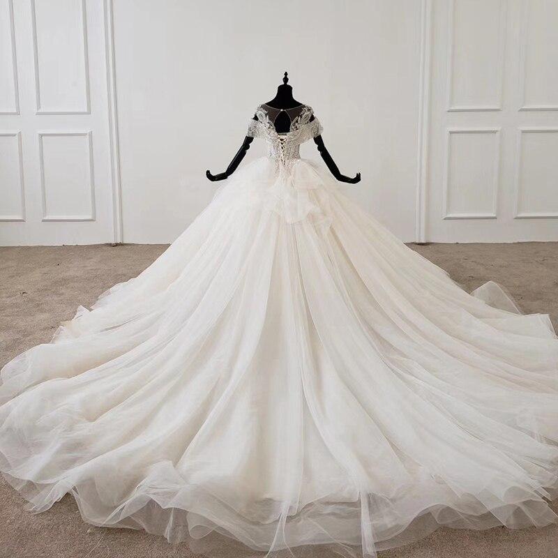 Image 2 - HTL1144 ball gown wedding dress boho boho plus size o neck lace up back corset bridal dress cap sleeve bead vestdos de noviaWedding Dresses   -