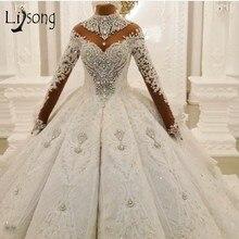 Vestidos de boda de diamantes de imitación de cristal de lujo de Dubái, Apliques de encaje, mangas completas, vestidos de baile hinchados, vestido de novia de flores 3D 2020